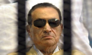 Hosni Mubarak in a cage in court during his trial in Cairo in 2012.