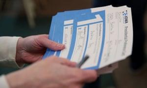 A precinct worker counts ballots in Iowa.