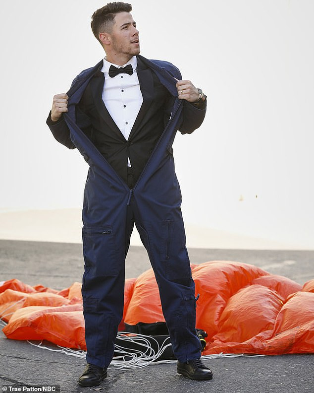 Unforgettable entrance: While his wife was overseas, Nick made his debut as a coach on NBC's The Voice. He parachuted onto the Voice lot, only to take off his jumpsuit to reveal a tuxedo