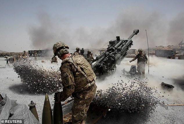 A 2011 file photo shows US Army soldiers from the 2nd Platoon fire a howitzer artillery shell in Panjwai district, Kandahar province, in southern Afghanistan. Since the invasion of Afghanistan in late 2001 2,440 US military personnel have died, along with 111,000 Afghan civillians and armed forces