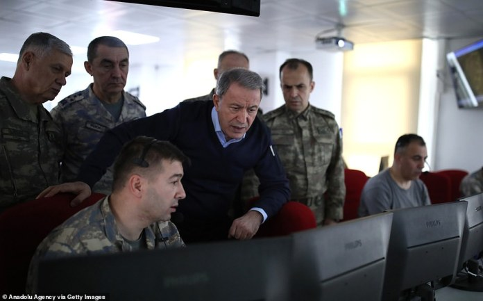Turkish National Defense Minister Hulusi Akar speaks to ground commanders about the situation in Idlib on Friday morning