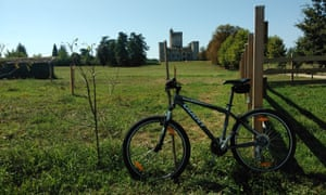 Mountain bike parked in front of Chateay