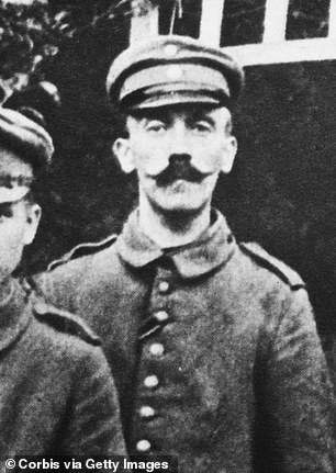 A solider who served with Adolf Hitler says he shaved his mustache from its long length (pictured) into is classic toothbrush shape so it would fit under a respirator during World War I. Pictured: Hitler in 1914