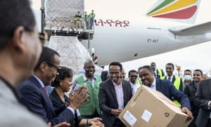 Ethiopian national coordinator Dr Shumete Gizaw, center-right, hands over a box of medical supplies to Minister of Health Dr Lia Tadesse, center-left, after a cargo flight containing over six million medical items arrived in the capital Addis Ababa, Ethiopia Sunday, March 22, 2020 from China.