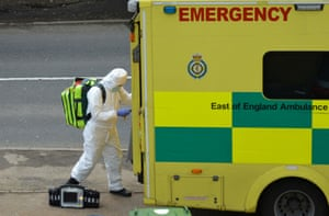 A paramedic in Hertfordshire wears protective clothing for a call-out.
