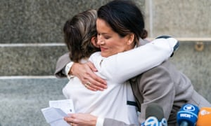 Tarale Wulff, right, hugs her lawyer Gloria Allred after the sentencing of Harvey Weinstein in New York on 11 March 2020