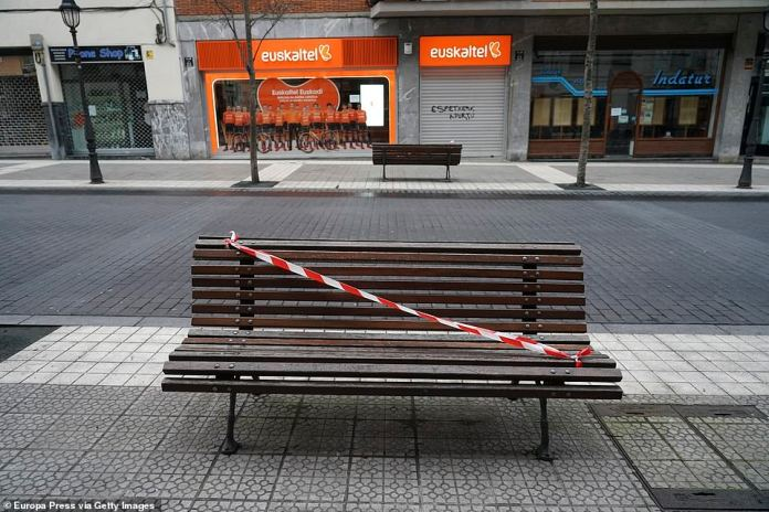 A bench is seen sealed during the second day of total confinement in Bilbao