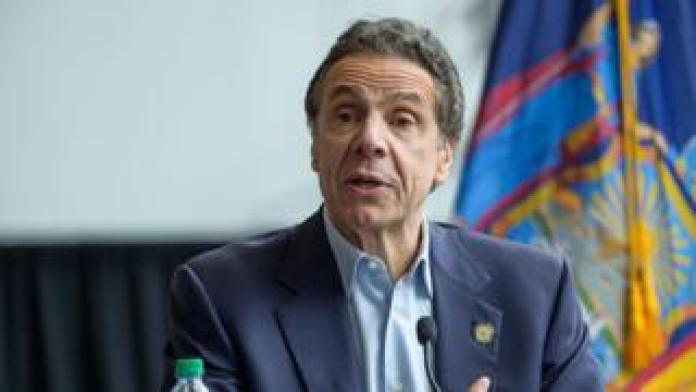 Andrew Cuomo giving a press conference