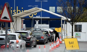 A queue at a drive-through testing station for NHS staff at the Wembley Ikea.