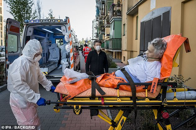 A patient is rushed away in an ambulance in Milan on Sunday.The death toll from the COVID-19 epidemic rose by 525 to 15,887, the lowest number of fatalities reported in a day by the civil protection service since the 427 registered on March 19.