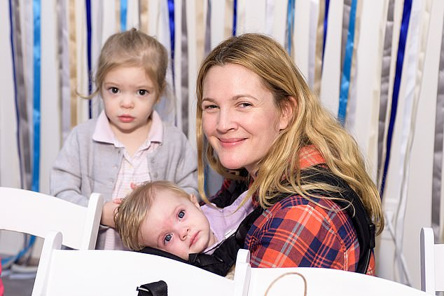 Being careful with her kids: Drew Barrymore doesn't want her daughters to act until they are older. The actress - who began her own career when she was just 11 months old - would support Olive, seven, and Frankie, six, if they wanted to follow in her footsteps but would rather wait until they are at least in their teens