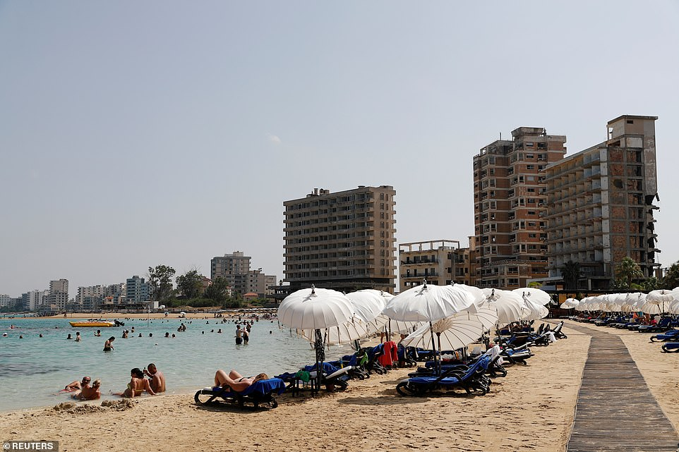 While beaches still attract crowds at the resort, the buildings that surround them are crumbling and falling down