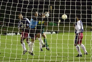 Archie Thompson of the Socceroos gets a goal past Nicky Salapu of American Sāmoa during the Oceania group one World Cup qualifier match in 2001