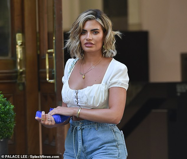 Looking good: Megan's blonde locks were styled into glamorous waves