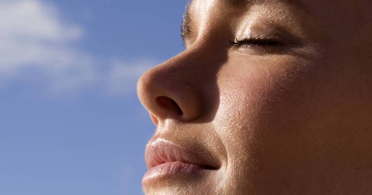 Does the sun really help acne? A dermatologist reveals what happens to your spots when you bask in UV rays