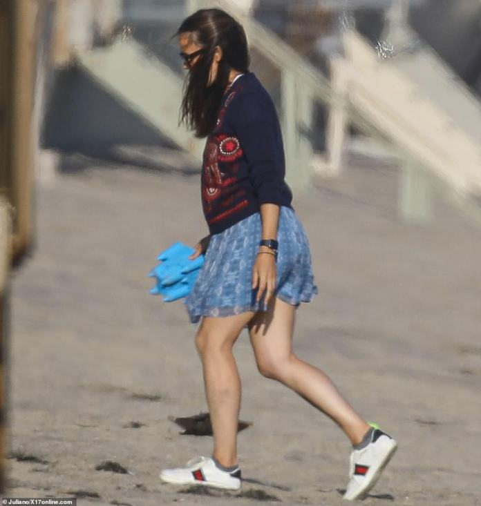 Cute ensemble: Jennifer looked stylish in a short blue skirt and a pair of Gucci sneakers