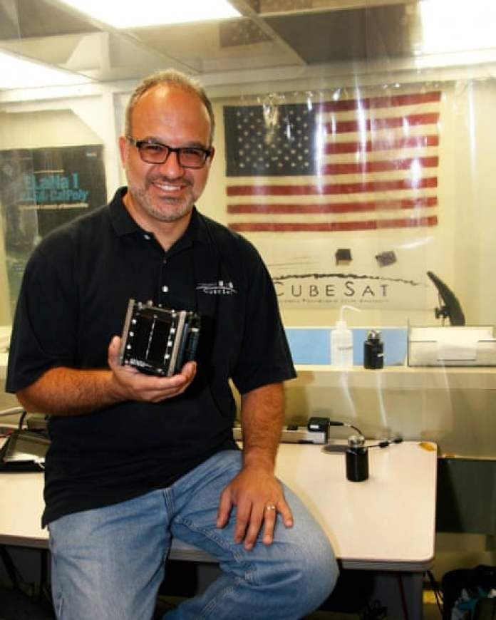 Jordi Puig-Suari holding a CubeSat, which he invented with Stanford professor Bob Twiggs.