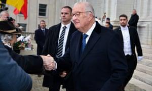 Retired King Albert II of Belgium shaking hands outside church