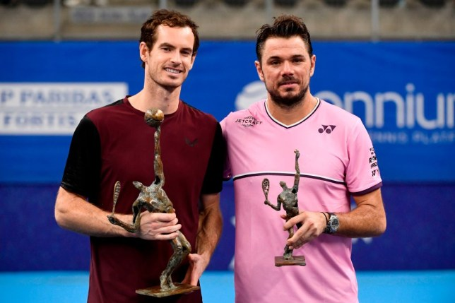 Winner Britain's Andy Murray (L) and second-placed Switzerland's Stanislas Wawrinka (R) celebrate with their trophies after competing in their men's single tennis final match of the European Open ATP Antwerp, on October 20, 2019 in Antwerp.