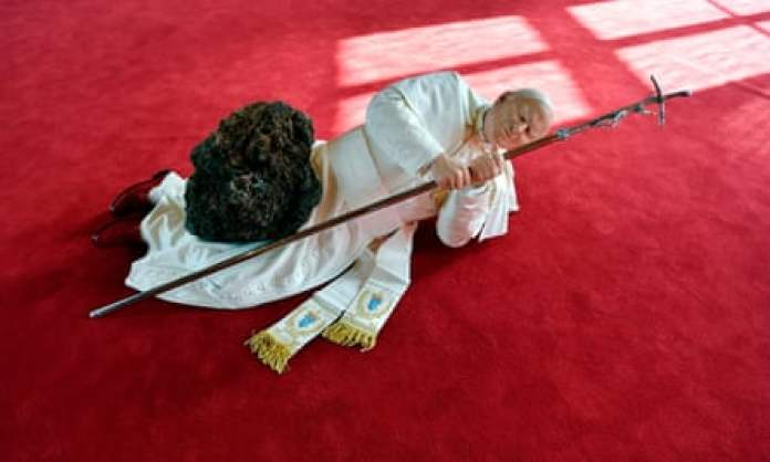 A sculpture by the Italian artist Maurizio Cattelan depicting Jean Paul II being crushed by a meterorite.
