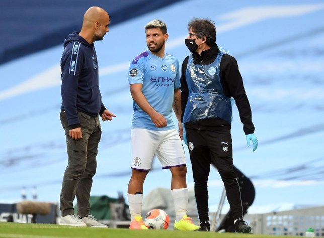 Manchester City's Argentinian striker Sergio Aguero (C) is substituted by Manchester City's Spanish manager Pep Guardiola (L) during the English Premier League football match between Manchester City and Burnley at the Etihad Stadium in Manchester, north west England, on June 22, 2020. (Photo by Michael Regan / POOL / AFP) / RESTRICTED TO EDITORIAL USE. No use with unauthorized audio, video, data, fixture lists, club/league logos or 'live' services. Online in-match use limited to 120 images. An additional 40 images may be used in extra time. No video emulation. Social media in-match use limited to 120 images. An additional 40 images may be used in extra time. No use in betting publications, games or single club/league/player publications. / (Photo by MICHAEL REGAN/POOL/AFP via Getty Images)