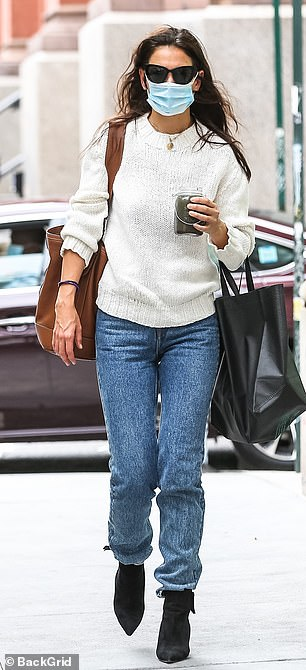 Day date: For their casual Sunday date, Katie wore a cream knit sweater and jeans with black suede booties