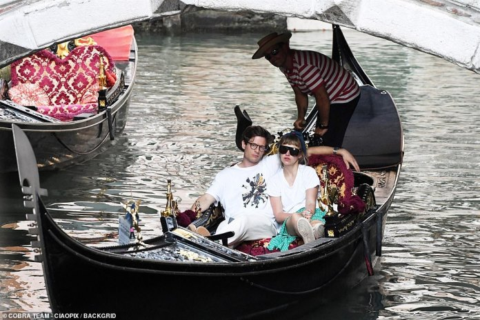 Relaxed and happy: The pair looked relaxed and happy as they meandered through the city's waters during their private ride