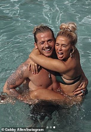 Sensational: The Love Island star, 28, looked sensational in a skimpy green bikini as she posed alongside shirtless Lyle during one of their recent sunny getaways together
