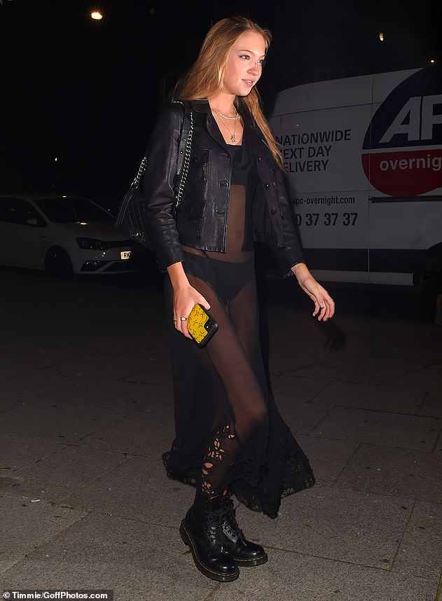 Stylish: Lila sported an all-black ensemble as she joined her famous mother to celebrate his birthday, after recently returning to London from their home in The Cotswolds