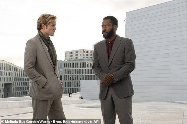 Generated $6.7M in US and Canada: The flick features John David Washington (R), Robert Pattinson (L), Aaron Taylor-Johnson, Michael Caine, and Kenneth Branagh