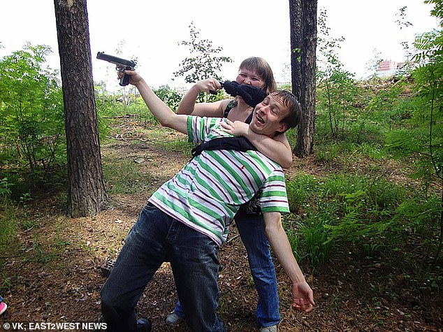 The married father-of-one, pictured playing with a gun with his wife in a forest, has confessed to the killings