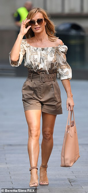 Stylish: She wowed in the summery outfit on Monday