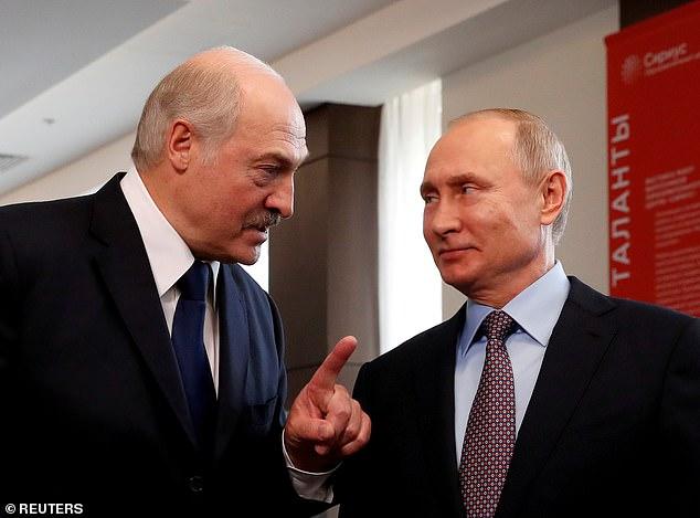 President Alexander Lukashenko of Belarus is seeking the backing of Russia's Vladimir Putin at a crucial meeting today (pictured, the pair in calmer times in February 2019)