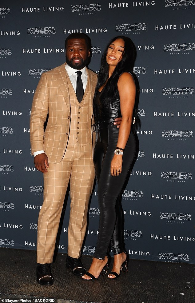 Out on the town: 50 Cent was snapped with his girlfriend Jamira 'Cuban Link' Haines in New York City on Wednesday, after he was called out by ex-girlfriend Chelsea Handler over his endorsement of Donald Trump