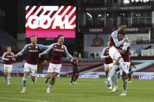 Aston Villa's Ollie Watkins, right, celebrates after scoring his side's fourth goal.