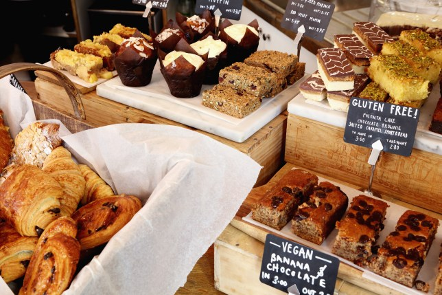 Independent coffee shop with display of vegan and gluten-free cakes.