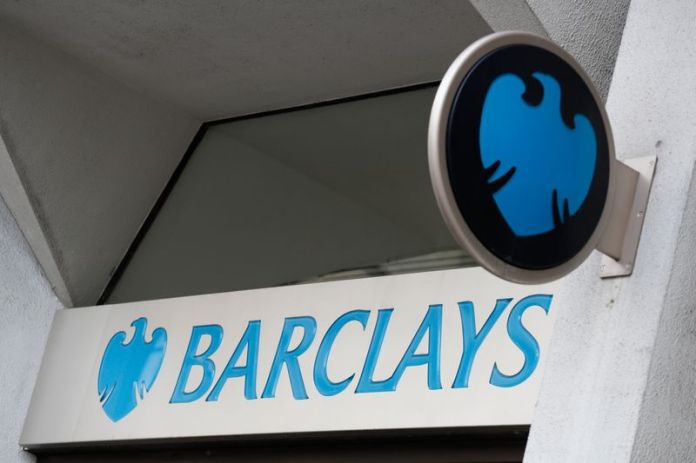 © Reuters. FILE PHOTO: A Barclays sign is seen outside a branch of the bank in London