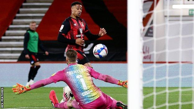 Arnaut Danjuma lifts the ball over Bristol City keeper Daniel Bentley to open the scoring for Bournemouth