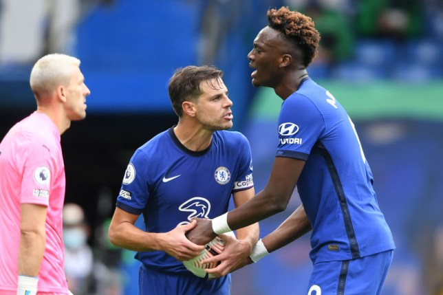 Chelsea's Spanish defender Cesar Azpilicueta (L) and Chelsea's English striker Tammy Abraham argue about the taking of the second penalty during the English Premier League football match between Chelsea and Crystal Palace at Stamford Bridge in London on October 3, 2020.