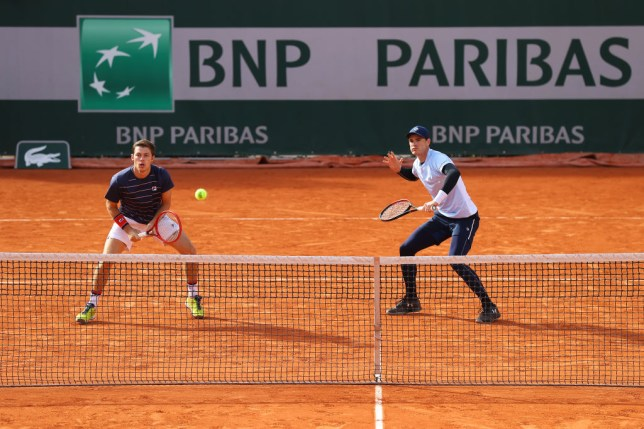 Jamie Murray and Neal Skupski of Great Britain play in their Men's Doubles third round match against Marcel Granollers of Spain and Horacio Zeballos of Argentina on day seven of the 2020 French Open at Roland Garros on October 03, 2020 in Paris, France.