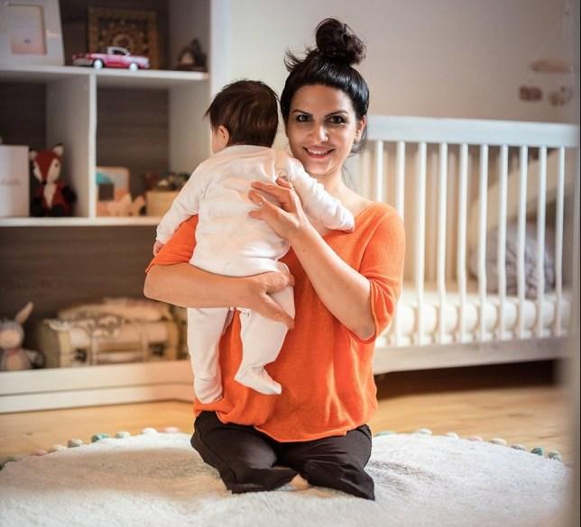 Mum who had legs amputated holding newborn