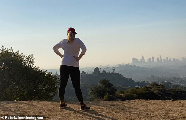 Almost there! Rebel Wilson revealed on Sunday that she was just three kilograms away from reaching her goal weight of 75kg (11.8 stone, or 165lbs). She shared this photo to Instagram of herself after a hike in Los Angeles, and told her followers she was edging closer to her target