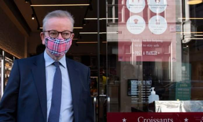 Michael Gove, chancellor of the duchy of Lancaster, leaving a coffee shop while wearing a mask.