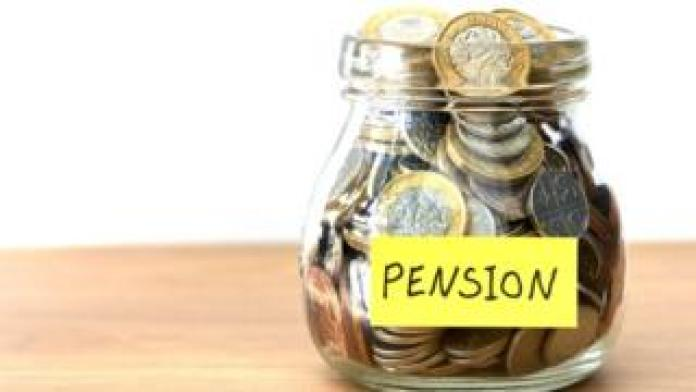 """Money in a jar marked """"pension"""""""