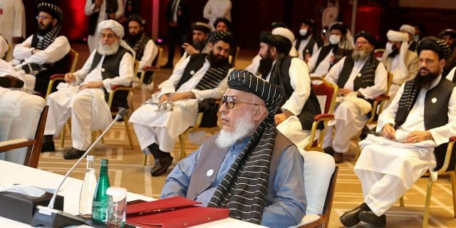 In this Sept. 12, 2020, file photo, Taliban negotiator Abbas Stanikzai, center front, and his delegation attend the opening session of peace talks between the Afghan government and the Taliban, in Doha, Qatar. Afghanistan's Taliban on Thursday, Oct. 8, 2020, (AP Photo/Hussein Sayed, File)