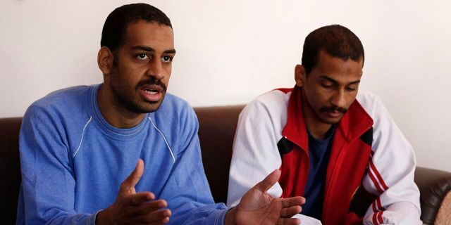 "FILE - In this March 30, 2019, file photo, Alexanda Amon Kotey, left, and El Shafee Elsheikh, who were allegedly among four British jihadis who made up a brutal Islamic State cell dubbed ""The Beatles,"" speak during an interview with The Associated Press at a security center in Kobani, Syria. (AP Photo/Hussein Malla, File)"