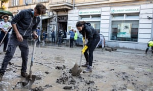 People clean up after flooding in Ventimiglia, northern Italy