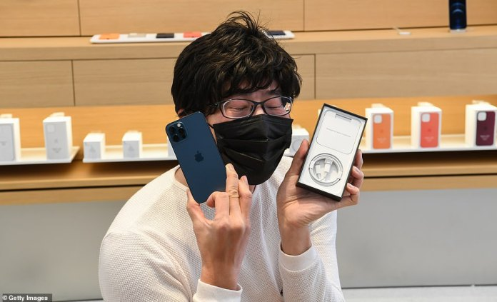 Jun, also Sydney's first iPhone 12 owner,enjoys his new purchase of the new Apple iPhone 12 inside the Apple Store in George Street