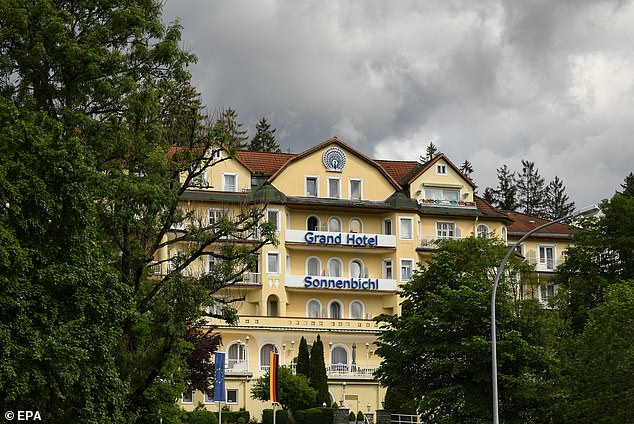 The Grand Hotel where the king is staying has seen most tourists stay away and the hotel's website says it is 'currently unavailable for bookings' because of the coronavirus pandemic, without mentioning its long-term guests