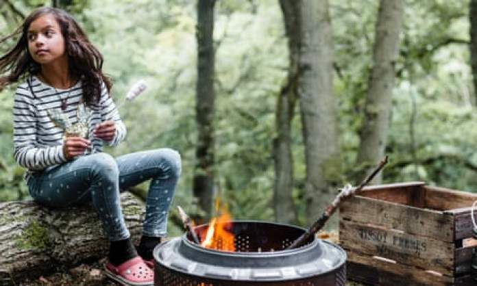 Child by bonfire at drovers rest shepherds shack